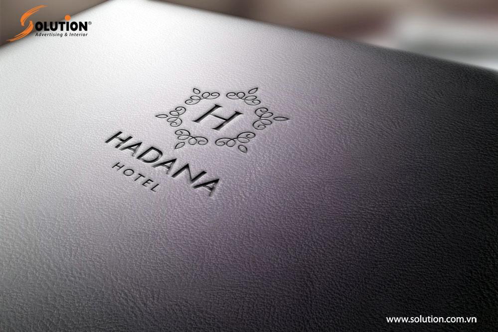 Mẫu sổ da in logo trong thiết kế bộ nhận diện thương hiệu Khách sạn Hadana